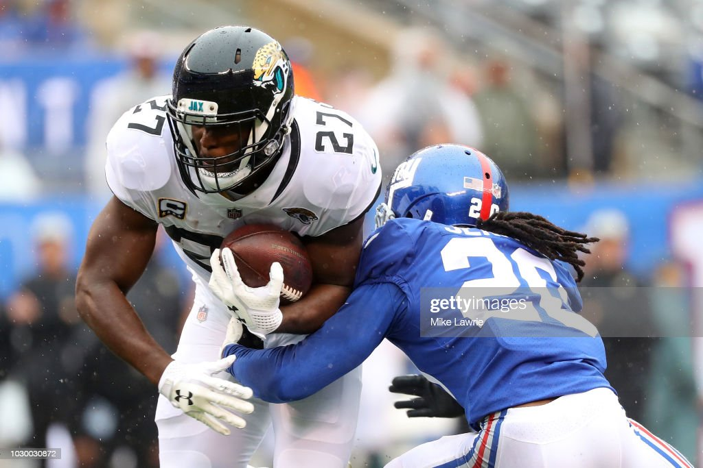 Leonard Fournette #27 of the Jacksonville Jaguars runs with the ball against Janoris Jenkins #20 of the New York Giants in the first quarter at MetLife Stadium on September 9, 2018 in East Rutherford, New Jersey.