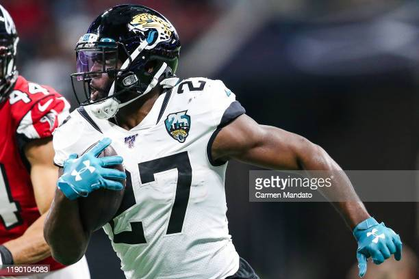 Leonard Fournette of the Jacksonville Jaguars rushes during the first half of a game against the Atlanta Falcons at MercedesBenz Stadium on December...