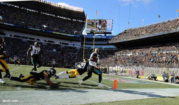 Leonard Fournette of the Jacksonville Jaguars rushes for an 18 yard touchdown in the first quarter during the AFC Divisional Playoff game against the...