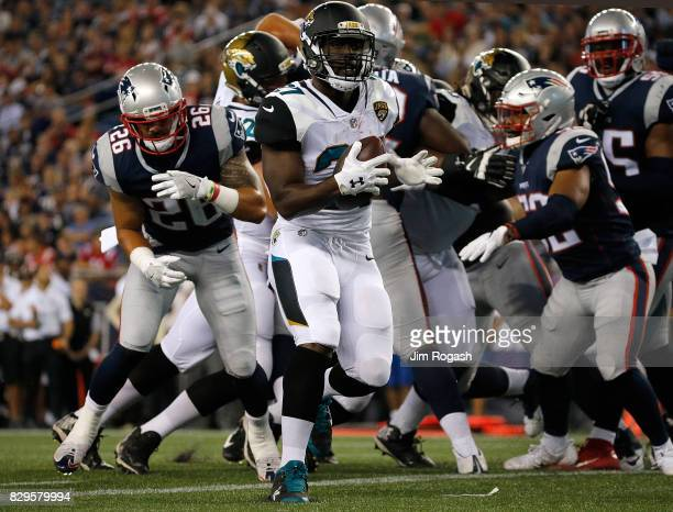 Leonard Fournette of the Jacksonville Jaguars scores a touchdown at the end of the second quarter against the New England Patriots during a preseason...