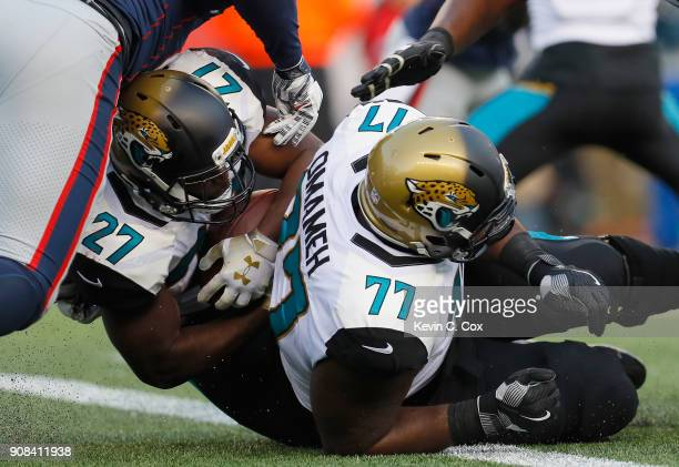Leonard Fournette of the Jacksonville Jaguars scores a touchdown in the second quarter during the AFC Championship Game against the New England...