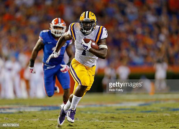 Leonard Fournette of the LSU Tigers carries the ball during the second quarter of the game against the Florida Gators at Ben Hill Griffin Stadium on...