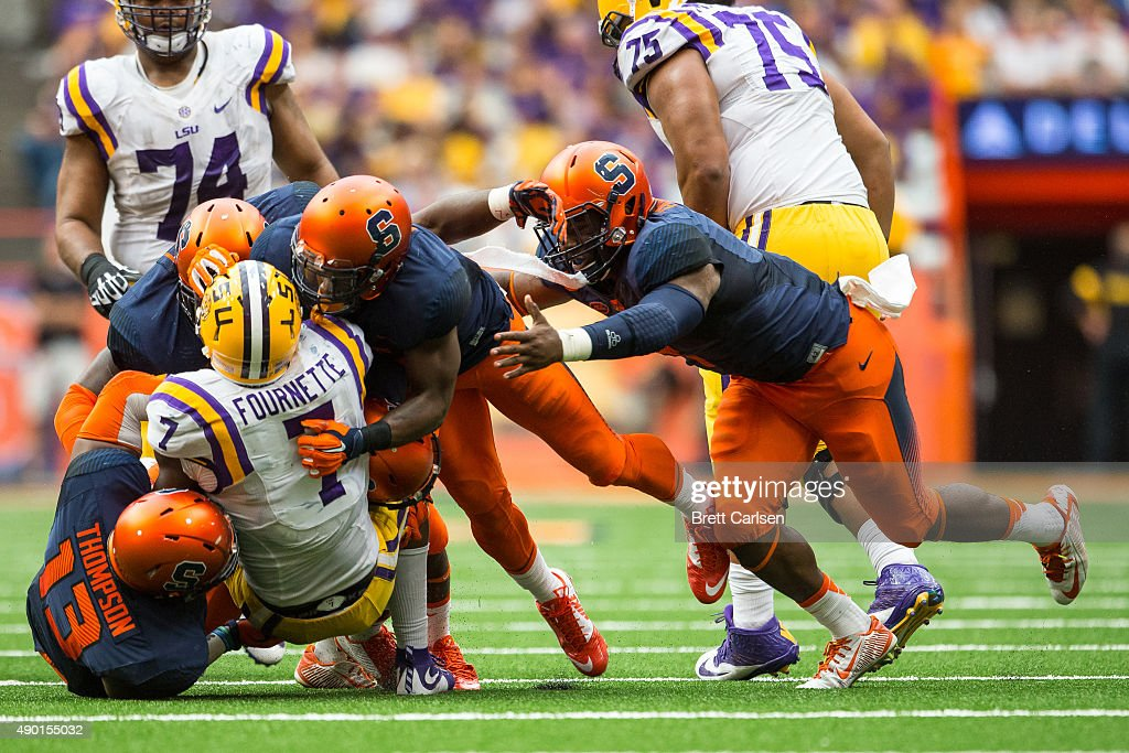 Leonard Fournette #7 of the LSU Tigers is stopped by a group of Syracuse Orange players during the second half on September 26, 2015 at The Carrier Dome in Syracuse, New York. LSU defeats Syracuse 34-24.