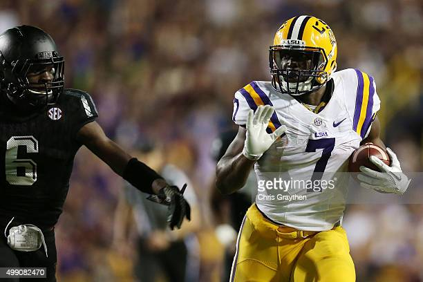 Leonard Fournette of the LSU Tigers is tackled by Donovan Wilson of the Texas AM Aggies at Tiger Stadium on November 28 2015 in Baton Rouge Louisiana