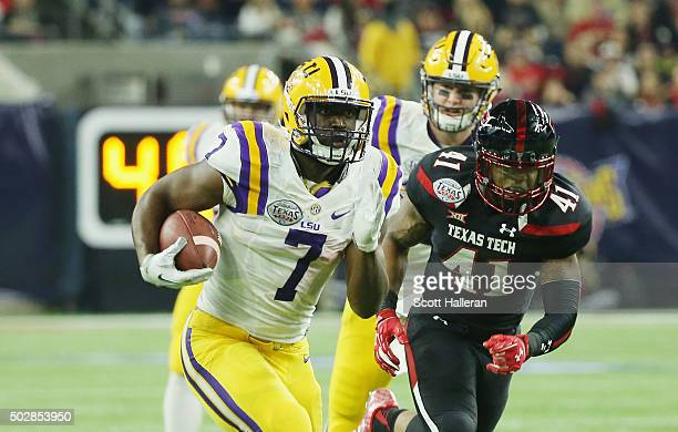 Leonard Fournette of the LSU Tigers runs for a 44yard touchdown during the first half of their game against the Texas Tech Red Raiders during the...
