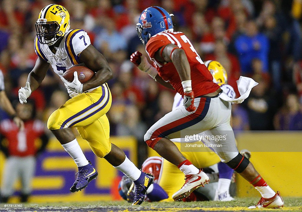 Leonard Fournette #7 of the LSU Tigers runs past DeMarquis Gates #3 of the Mississippi Rebels during the second half of a game at Tiger Stadium on October 22, 2016 in Baton Rouge, Louisiana.
