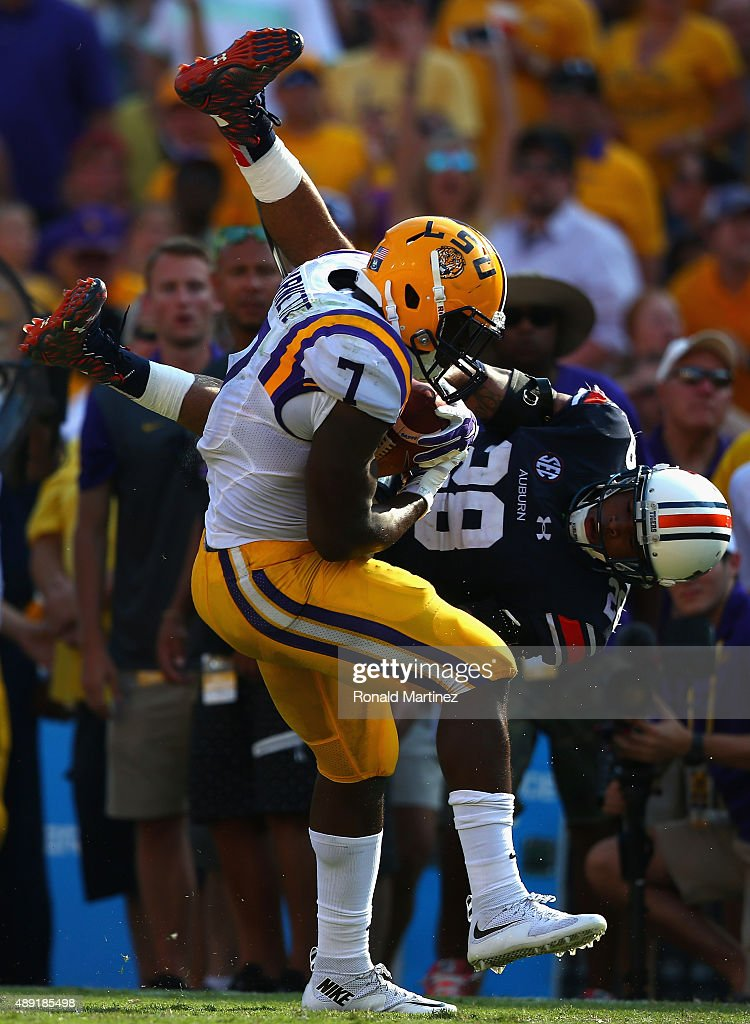 Leonard Fournette #7 of the LSU Tigers runs past the attempted tackle by Tray Matthews #28 of the Auburn Tigers at Tiger Stadium on September 19, 2015 in Baton Rouge, Louisiana.
