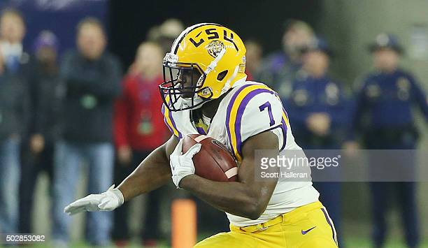 Leonard Fournette of the LSU Tigers runs with the ball during the first half of their game against the Texas Tech Red Raiders during the AdvoCare...