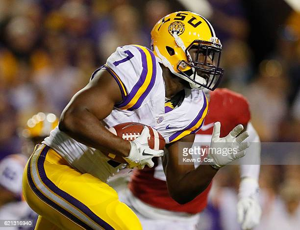 Leonard Fournette of the LSU Tigers rushes against the Alabama Crimson Tide at Tiger Stadium on November 5 2016 in Baton Rouge Louisiana