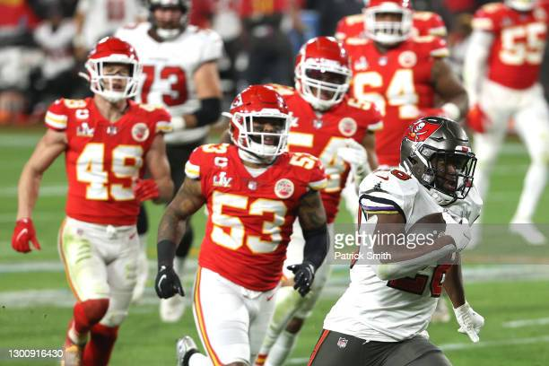 Leonard Fournette of the Tampa Bay Buccaneers runs for a 27 yard touchdown in the third quarter against the Kansas City Chiefs in Super Bowl LV at...