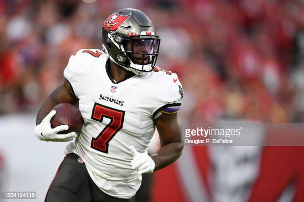 Leonard Fournette of the Tampa Bay Buccaneers runs the ball during the first quarter against the Cincinnati Bengals during a preseason game at...