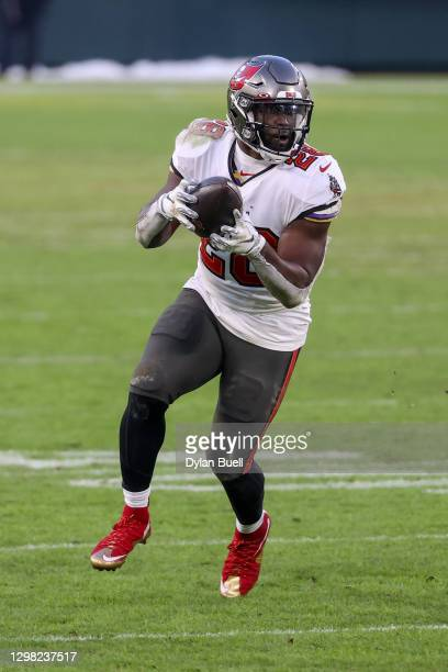 Leonard Fournette of the Tampa Bay Buccaneers runs with the ball in the fourth quarter against the Green Bay Packers during the NFC Championship game...