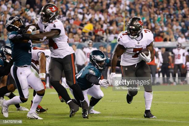 Leonard Fournette of the Tampa Bay Buccaneers rushes the ball against the Philadelphia Eagles at Lincoln Financial Field on October 14, 2021 in...