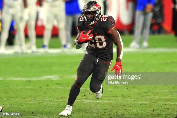 Leonard Fournette of the Tampa Bay Buccaneers rushes the ball during the fourth quarter in the game against the Los Angeles Rams at Raymond James...