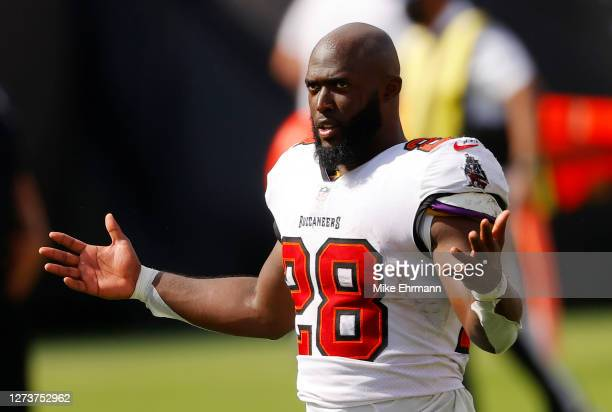 Leonard Fournette of the Tampa Bay Buccaneers walks off the field after defeating the Carolina Panthers 31-17 at Raymond James Stadium on September...
