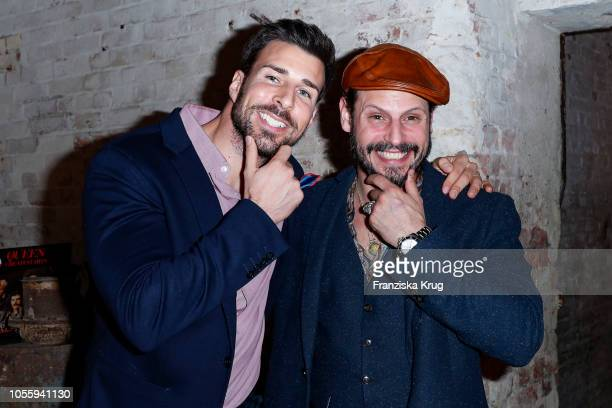 Leonard Freier and Manuel Cortez during the Movember X Men Expert Barber Club Charity event at Musikbrauerei on October 31 2018 in Berlin Germany