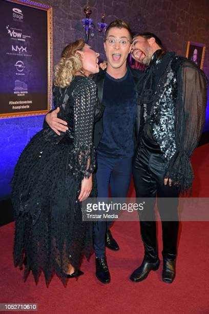 Leonard Freier his wife Caona Freier and Julian David attend the musical premiere of 'Tanz der Vampire' at Theater des Westens on October 21 2018 in...