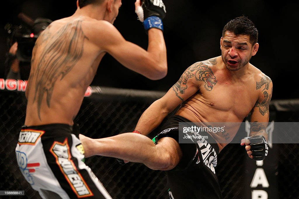 Leonard Garcia kicks Max Holloway during their featherweight fight at UFC 155 on December 29, 2012 at MGM Grand Garden Arena in Las Vegas, Nevada.
