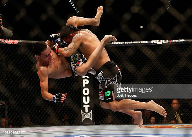 Leonard Garcia slams Max Holloway during their featherweight fight at UFC 155 on December 29 2012 at MGM Grand Garden Arena in Las Vegas Nevada