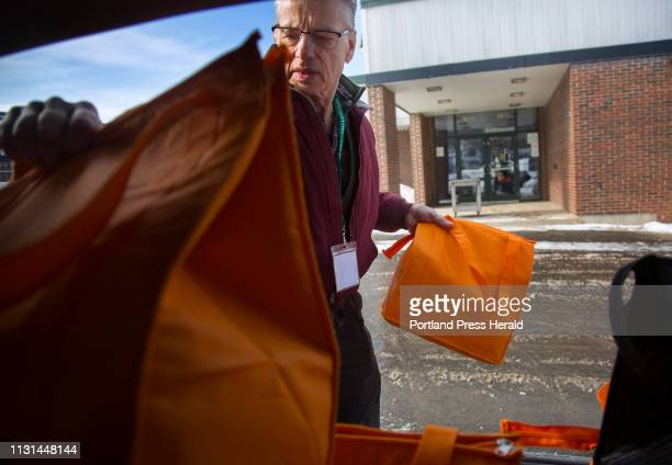 Leonard Guralnick of Portland volunteers at Meals on Wheels which operates out of the Westbrook Community Center Guralnick loads bags of food into...
