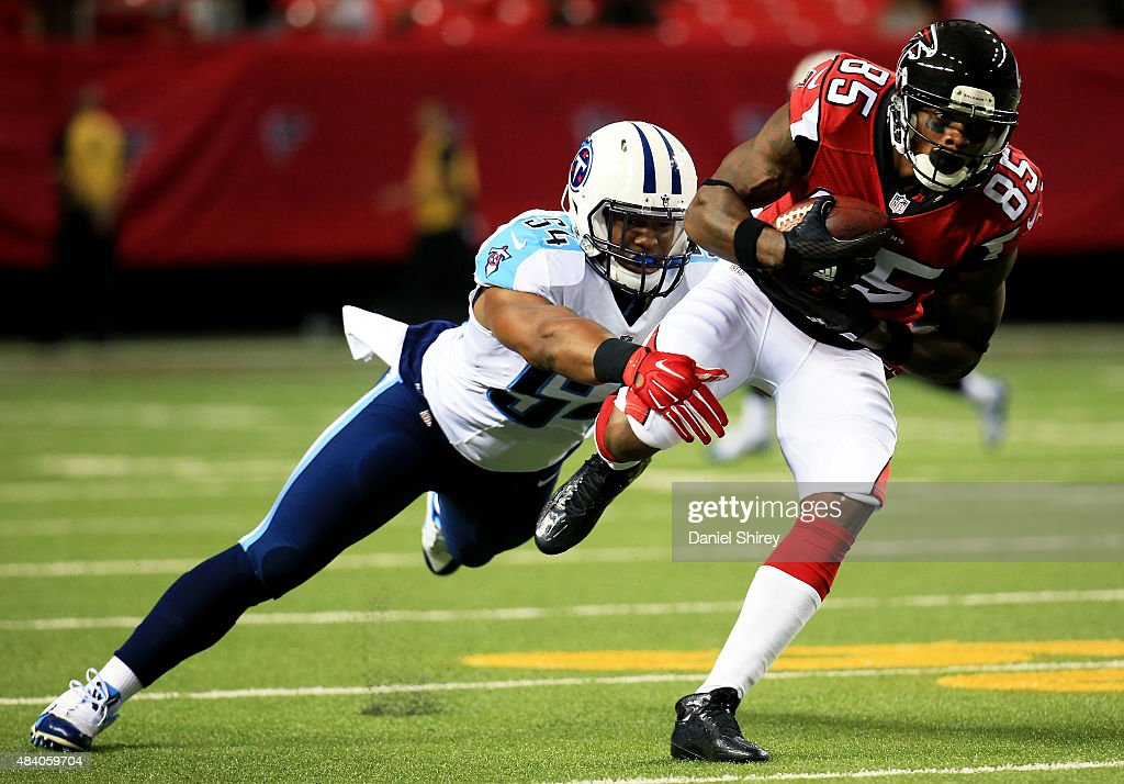 Leonard Hankerson #85 of the Atlanta Falcons is tackled by Avery Williamson #54 of the Tennessee Titans after a catch in the first half of a preseason game at the Georgia Dome on August 14, 2015 in Atlanta, Georgia.