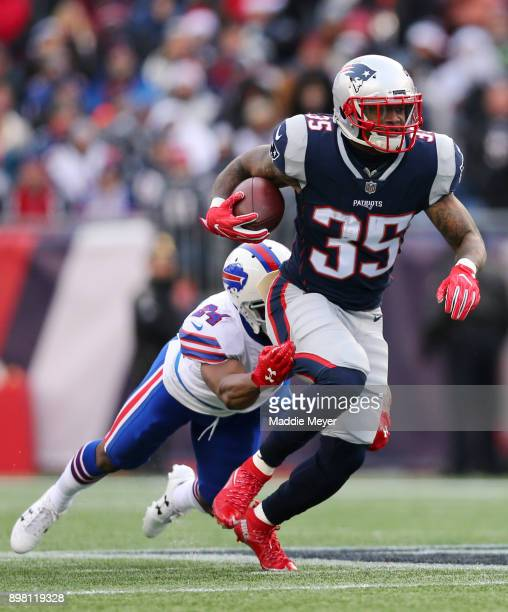 Leonard Johnson of the Buffalo Bills tackles Mike Gillislee of the New England Patriots during the second half at Gillette Stadium on December 24,...