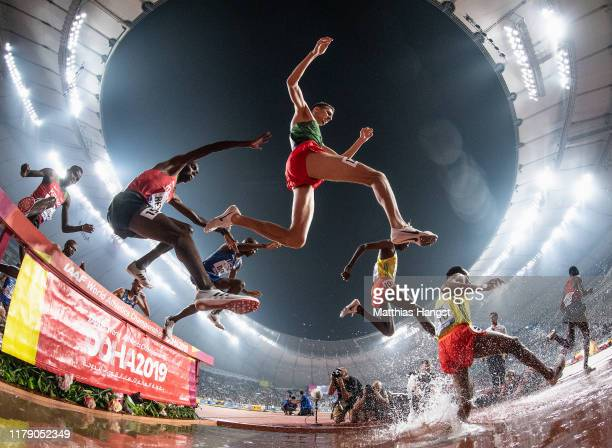 Leonard Kipkemoi Bett of Kenia and Soufiane El Bakkali of Morocco clear the water jump as they compete in the Men's 3000 metres Steeplechase final...