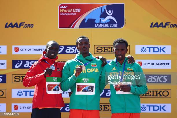 Leonard Kipkemoi Bett of Kenya Takele Nigate of Ethiopia and Getnet Wale of Ethiopia celebrate with their medals during the medal ceremony for the...