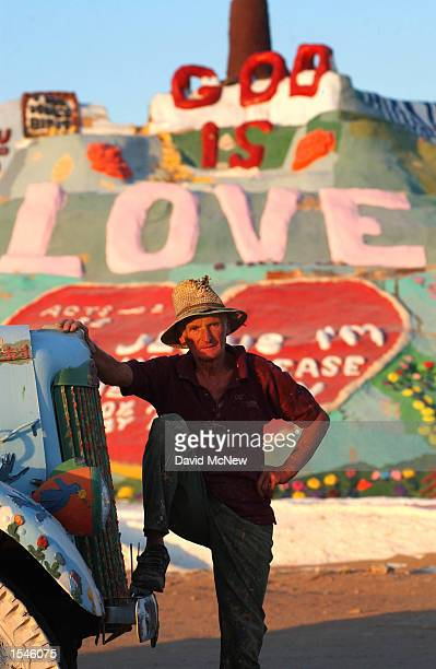 Leonard Knight stands before the message 'God is love' which dominates the Biblical messages on Salvation Mountain May 30 2002 near Niland CA east of...