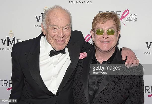 Leonard Lauder chairman of Estee Lauder companies and Elton John walk the red carpet at the Breast Cancer Research Foundation's Hot Pink Party at the...