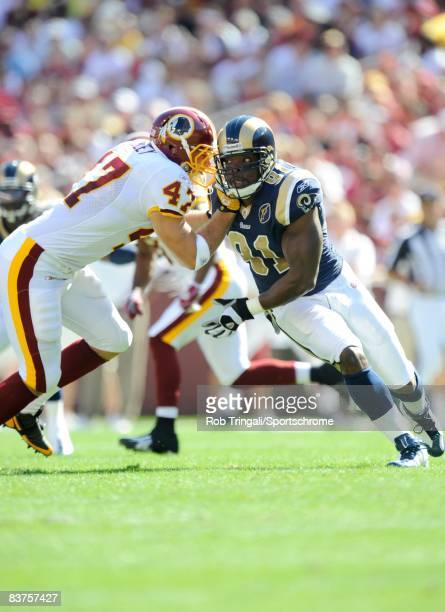 Leonard Little of the St. Louis Rams defends against Chris Cooley of the Washington Redskins at FedEx Field on October 12, 2008 in Landover,...
