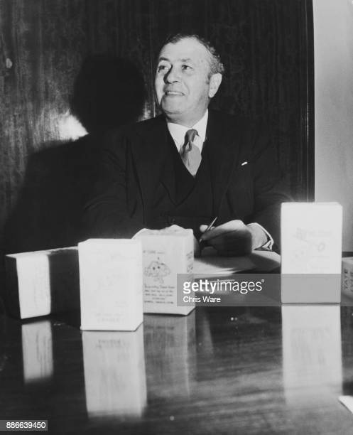 Leonard Lyle 1st Baron Lyle of Westbourne with some of the Tate Lyle sugar boxes bearing the antinationalisation propaganda figure of Mr Cube at...
