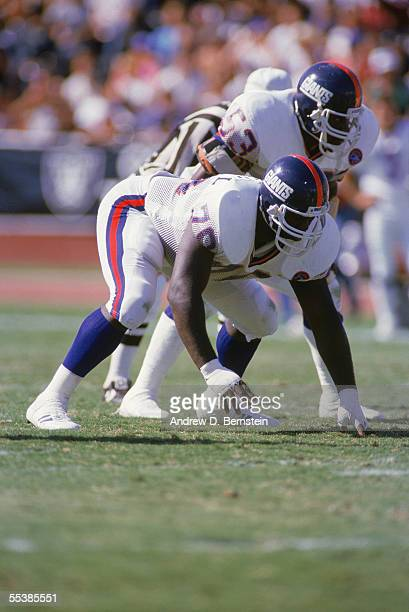 Leonard Marshall and Harry Carson of the New York Giants are in position at the Line of Scrimmage during a game in September of 1986