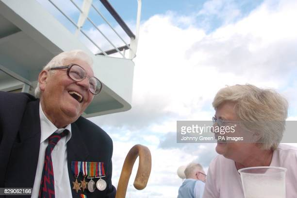 Leonard Martin from Bude north Cornwall shares a joke with Marge Traves from Poole in Dorset aboard the ferry MV Van Gogh as it prepares to set sail...