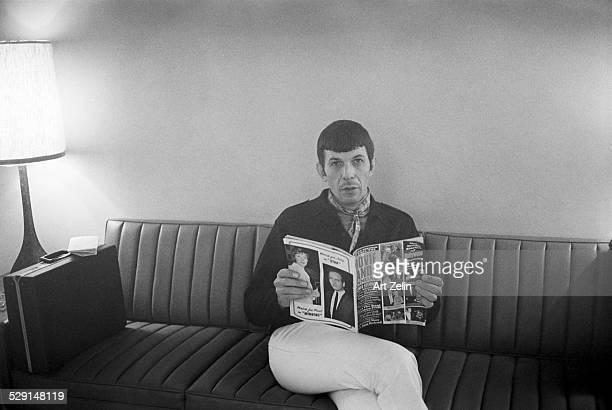 Leonard Nimoy reading a magazine waiting for interview; circa 1970; New York.