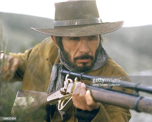 Leonard Nimoy, US actor, wearing a cowboy hat while aiming a rifle in a publicity still issued for the film, 'Catlow', 1971. The Western, directed by...