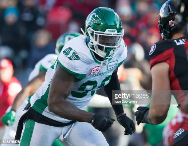 AC Leonard of the Saskatchewan Roughriders rushes the Ottawa Redblacks pass in Canadian Football League play during the CFL East Division SemiFinal...