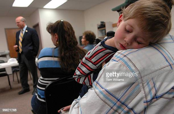 Leonard Rice holds his son Chance at a meeting with Rep Steve Pearce RNM at Luna Community College in Santa Rosa NM