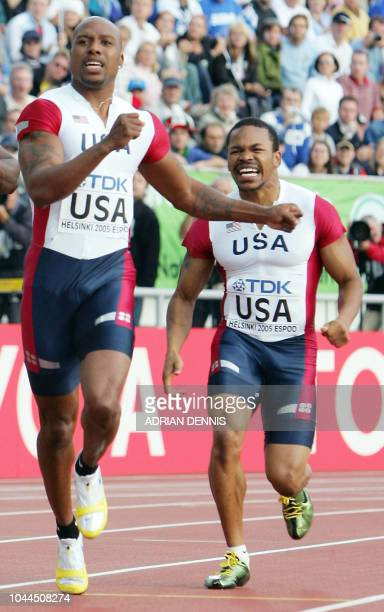 US Leonard Scott and US Mardy Scales react after dropping the stick during the men's 4x100m relay heats at the 10th IAAF World Athletics...