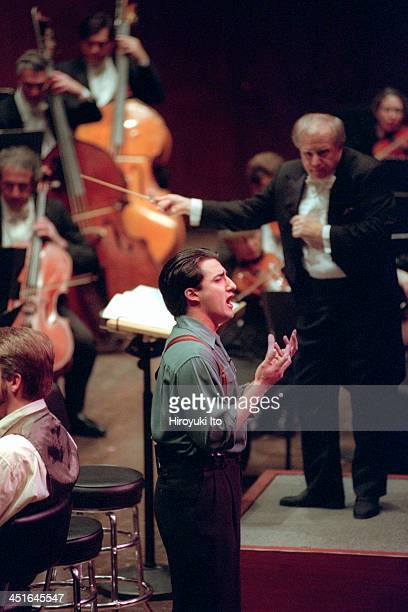 Leonard Slatkin leading the New York Philharmonic at Avery Fisher Hall on Saturday night March 11 2000They performed the music of Bernstein Pugh and...