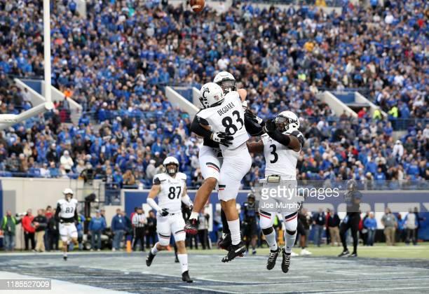 Leonard Taylor of the Cincinnati Bearcats celebrates a touchdown with Josiah Deguara against the Memphis Tigers on November 29, 2019 at Liberty Bowl...