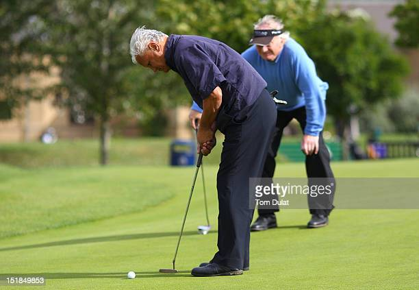 Leonard Tolster of West Midlands Golf Club makes a putt during the PGA Super 60's Tournament at the De Vere Belton Woods Golf Club on September 12...