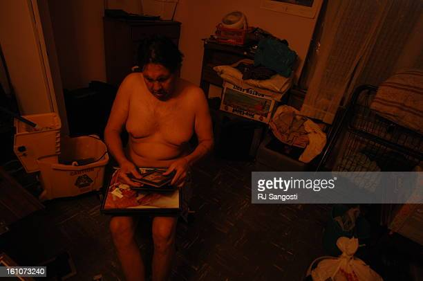BROWNING MONTANA Leonard Villa Sr searches for photos of his son in the dark of his home on the Blackfeet Reservation in Browning MO His son who's...