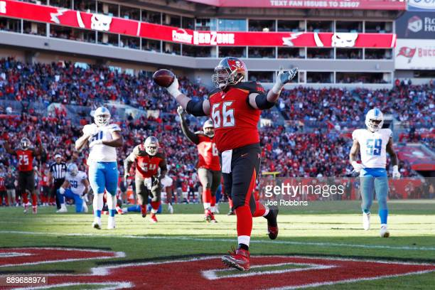Leonard Wester of the Tampa Bay Buccaneers reacts after making a twoyard touchdown reception against the Detroit Lions in the fourth quarter of a...