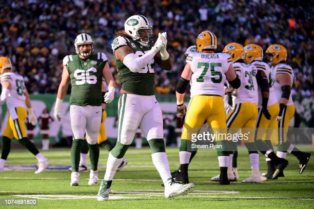 Leonard Williams of the New York Jets celebrates a tackle against the Green Bay Packers during the first quarter at MetLife Stadium on December 23...