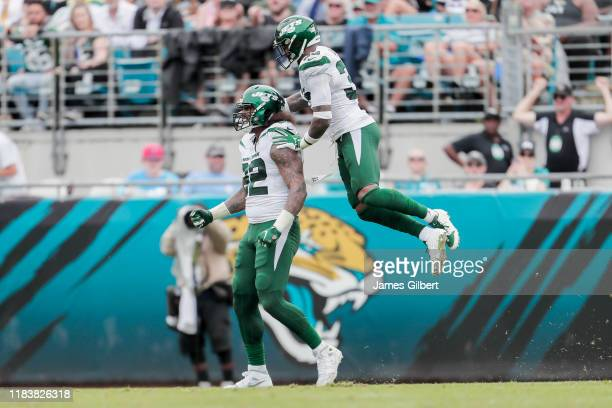 Leonard Williams of the New York Jets celebrates with his teammate Jamal Adams after making a defensive stop during the third quarter of a game...