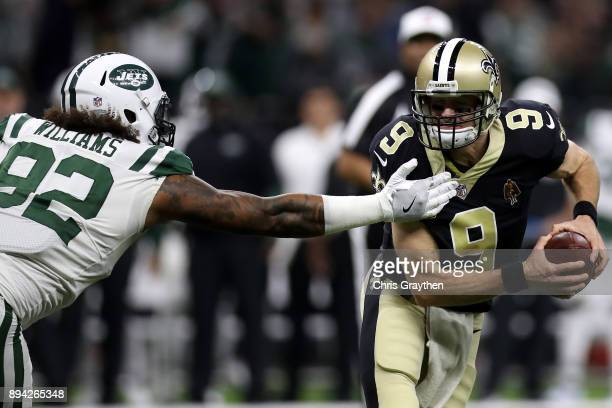 Leonard Williams of the New York Jets pressures Drew Brees of the New Orleans Saints during the first half of a game at the MercedesBenz Superdome on...