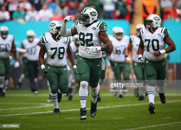 Leonard Williams of the New York Jets runs onto the field with team mates prior to the game against Miami Dolphins at Wembley Stadium on October 4...