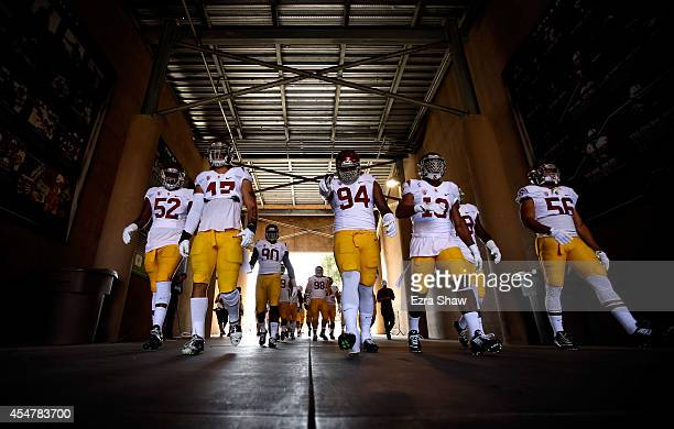 Leonard Williams of the USC Trojans walks down to the tunnel with his teammates to warm up for their game against the Stanford Cardinal at Stanford...