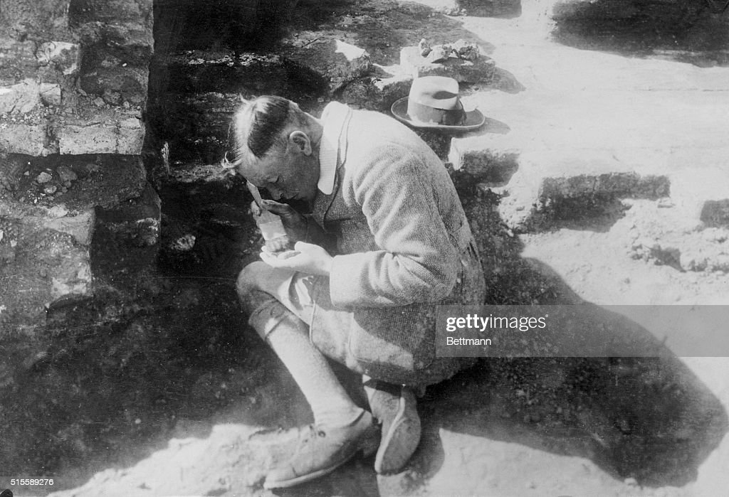 C Leonard Woolley Brushing off Find at Dig : News Photo